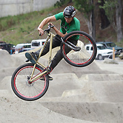 Conor MacFarlane from Queenstown in action during the Gorge Road Mega Jam, for BMX and Mountain Bike riders to mark the opening  of the Gorge Road Jump Park run by the Queenstown Mountain Bike Club, Queenstown, New Zealand. 3rd December 2011. Photo Tim Clayton