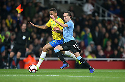 Brazil's Danilo (left) and Uruguay's Diego Laxalt (right) battle for the ball during the International Friendly match at the Emirates Stadium, London.