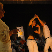 "Conny Degraaf, left, a professional judge of amateur and latin ballroom (and a 9-time former Belgian ballroom dancing champion)from Antwerp, Belgium, judges the adult men's latin division of the same-sex ballroom dancing competition during the 2007 Eurogames at the Waagnatie hangar in Antwerp, Belgium on July 14, 2007. ..""I like it,"" said Degraaf, who had never before judged or even seen a same-sex dancing event. ""I was a little afraid. I've been judging 20 years...but it was just like normal dancing.  I like it.""..Over 3,000 LGBT athletes competed in 11 sports, including same-sex dance, during the 11th annual European gay sporting event. Same-sex ballroom is a growing sports that has been happening in Europe for over two decades."