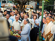 21 AUGUST 2015 - BANGKOK, THAILAND:  A Brahmin priest leads a Brahmin prayer at the Erawan Shrine Friday. The Bangkok Metropolitan Administration (BMA) held a religious ceremony Friday for the Ratchaprasong bomb victims. The ceremony started with a Brahmin blessing at Erawan Shrine, which was the target of a bombing Monday night. After the blessing people went across the street to the plaza in front of Central World mall for an interfaith religious service. Theravada Buddhists, Mahayana Buddhists, Muslims, Sikhs, Hindus, and Christians participated in the service. Life at the shrine, one of the busiest in Bangkok, is returning to normal. Friday the dancers and musicians who perform at the shrine resumed their schedules.        PHOTO BY JACK KURTZ