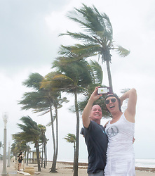 Two girls take a selfie along the beach with heavy winds and threatening skies in anticipation for Hurricane Irma Saturday, September 9, 2017 in Hollywood, FL, USA. Photo by Paul Chiasson/CP/ABACAPRESS.COM