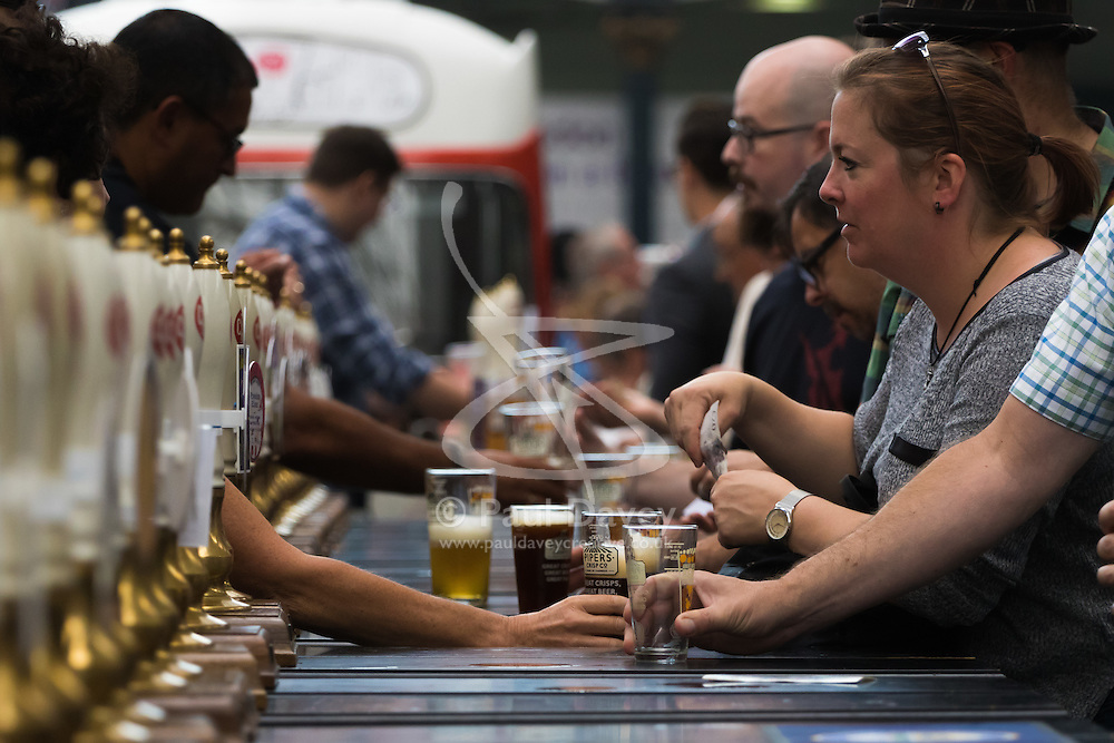 Olympia, London, August 9th 2015. Hundreds of real ale lovers attend the Campaign for Real Ale  Great British Beer Festival at London's Olympia Exhibition Centre, where dozens of independent breweries demonstrate the diversity of British brewed beers. PICTURED: Dozens of beer pumps distribute hundreds of different British brewed beers.