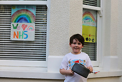 © Licensed to London News Pictures. 07/05/2020. London, UK. A child in Haringey, north London takes part in 'Clap For Our Carers' by applauding NHS staff, carers and key workers. The campaign has been encouraging people across the UK to take part in a round of applause from their windows, doors and front gardens to show their appreciation for the efforts of the NHS staff, carers and key workers during the COVID-19 pandemic. Photo credit: Dinendra Haria/LNP