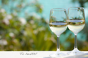 Two glasses of white wine with background out of focus