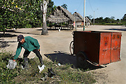 In the village of Dinomarko a community volunteer collects discarded rubbish. There is a growing problem in Amazonian communities with the build-up of plastic and unrecyclable rubbish. Alianza Arkana runs several waste management programs in communities to help them look after and recycle their waste.