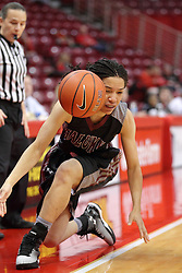 04 January 2015:  Blair Stephenson stumbles out of bounds trying to get past Taylor Stewart during an NCAA MVC (Missouri Valley Conference) women's basketball game between the Southern Illinois Salukis and the Illinois Sate Redbirds at Redbird Arena in Normal IL