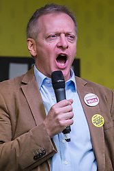 London, UK. 23rd March, 2019. Dr Phillip Lee, Conservative MP for Bracknell, addresses a million people taking part in a People's Vote rally in Parliament Square following a march from Park Lane.