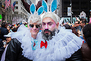 New York, NY - 21 April 2019. Two men with bunny ears and white ruffs at the Easter Bonnet Parade and Festival on New York's Fifth Avenue.