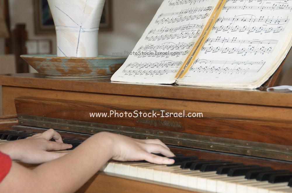 Young pianist, a 13 year old boy playing the piano