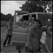 Undocumented Mexican workers pick tobacco in the sweltering heat of the eastern North Carolina tobacco fields. Many work barefoot in the mud exposing their feet to a toxic mixture of pesticides and nicotine which can cause their feet to turn black.