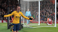 Football - 2017 / 2018 UEFA Europa League - Semi-Final, First Leg: Arsenal vs. Atletico Madrid<br /> <br /> Antoine Griezmann (Atletico Madrid) celebrates after scoring the equaliser with Shkodran Mustafi (Arsenal FC) sitting on grass after his error gifted the goal at The Emirates.<br /> <br /> COLORSPORT/DANIEL BEARHAM