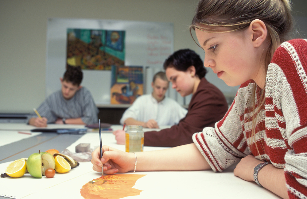 Art students painting still life of fruit; Chelmsford College; UK