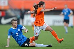 20-05-2015 NED: Nederland - Estland vrouwen, Rotterdam<br /> Oefeninterland Nederlands vrouwenelftal tegen Estland. Dit is een 'uitzwaaiwedstrijd'; het is de laatste wedstrijd die de Nederlandse vrouwen spelen in Nederland, voorafgaand aan het WK damesvoetbal 2015 / Daniëlle van de Donk #11, Liis Pello #2