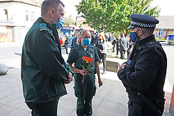 ©Licensed to London News Pictures 26/09/2020  <br /> Croydon, UK. Paramedics with flowers for Sgt Matt Ratana at Croydon Custody Centre. A murder investigation has been launched by police after the death of custody police sergeant Matt Ratana at the Croydon Custody Centre in South London yesterday.Photo credit:Grant Falvey/LNP