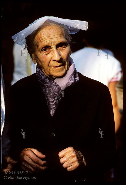 Old woman with traditional head-dress at a 'pardon' festival in town of Crac'h;Morbihan, Brittny France
