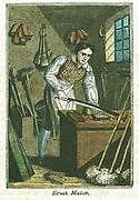 Brushmaker: Craftsman at bench prepares brushes to receiving backing. Around workshop are brooms, brushes and mops of various sizes.  Hand-coloured wooodcut from 'The Book of English Trades' London 1823