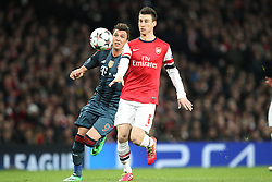 19.02.2014, Emirates Stadion, London, ENG, UEFA CL, FC Arsenal vs FC Bayern Muenchen, Achtelfinale, im Bild l-r: im Zweikampf, Aktion, mit Mario MANDZUKIC #9 (FC Bayern Muenchen), Laurent KOSCIELNY #6 (FC Arsenal London) // during the UEFA Champions League Round of 16 match between FC Arsenal and FC Bayern Munich at the Emirates Stadion in London, Great Britain on 2014/02/19. EXPA Pictures © 2014, PhotoCredit: EXPA/ Eibner-Pressefoto/ Kolbert<br /> <br /> *****ATTENTION - OUT of GER*****