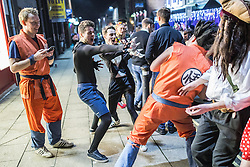 © Licensed to London News Pictures . 27/12/2016 . Wigan , UK . Dragon Ball Z themed outfits and play . Revellers in Wigan enjoy Boxing Day drinks and clubbing in Wigan Wallgate . In recent years a tradition has been established in which people go out wearing fancy-dress costumes on Boxing Day night . Photo credit : Joel Goodman/LNP
