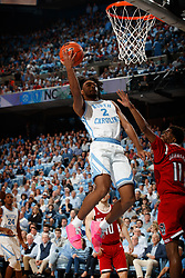 CHAPEL HILL, NC - FEBRUARY 05: Coby White #2 of the North Carolina Tar Heels goes to the basket during a game against the North Carolina State Wolfpack on February 05, 2019 at the Dean Smith Center in Chapel Hill, North Carolina. North Carolina won 113-96. North Carolina wore retro uniforms to honor the 50th anniversary of the 1967-69 team. (Photo by Peyton Williams/UNC/Getty Images) *** Local Caption *** Coby White