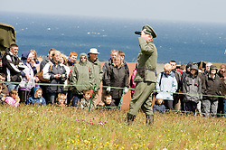 Member of the Northern World War Two Association portraying a Major from 1st company 1st Battalion GrossDeutschland Division German Army surveys the area through field glasses before a major Battle Reenactment.Scarborough  Sunday 30th May 2010 .Images © Paul David Drabble.