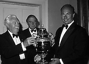 The Aga Khan hands over the new Nations Cup to the President of the Royal Dublin Society (RDS), Ballsbridge, Dublin. The trophy was first presented over 50 years earlier. The new cup is the 6th trophy to be presented for the international horse competition...1980-08-07.7th August 1980.07/08/1980.08-07-80..Photographed at the Royal Dublin Society...From Left:..Professor John Carroll..Professor James Meehan, Chairman Executive Committee, RDS..The Aga Khan