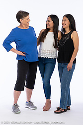 Vicki Kinzie (L) with sisters Alma and Yoli (R) Chavez at the Intercambio portrait Shoot. Longmont, CO, USA. June 5, 2021. Photography ©2021 Michael Lichter. Usage rights granted to Intercambio Uniting Communities and its assigns.