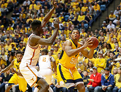 Jan 20, 2018; Morgantown, WV, USA; West Virginia Mountaineers forward Sagaba Konate (50) shoots in the lane during the second half against the Texas Longhorns at WVU Coliseum. Mandatory Credit: Ben Queen-USA TODAY Sports