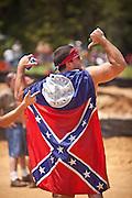 A participant wears a confederate Georgia flag during the annual Summer Redneck Games Dublin, GA.