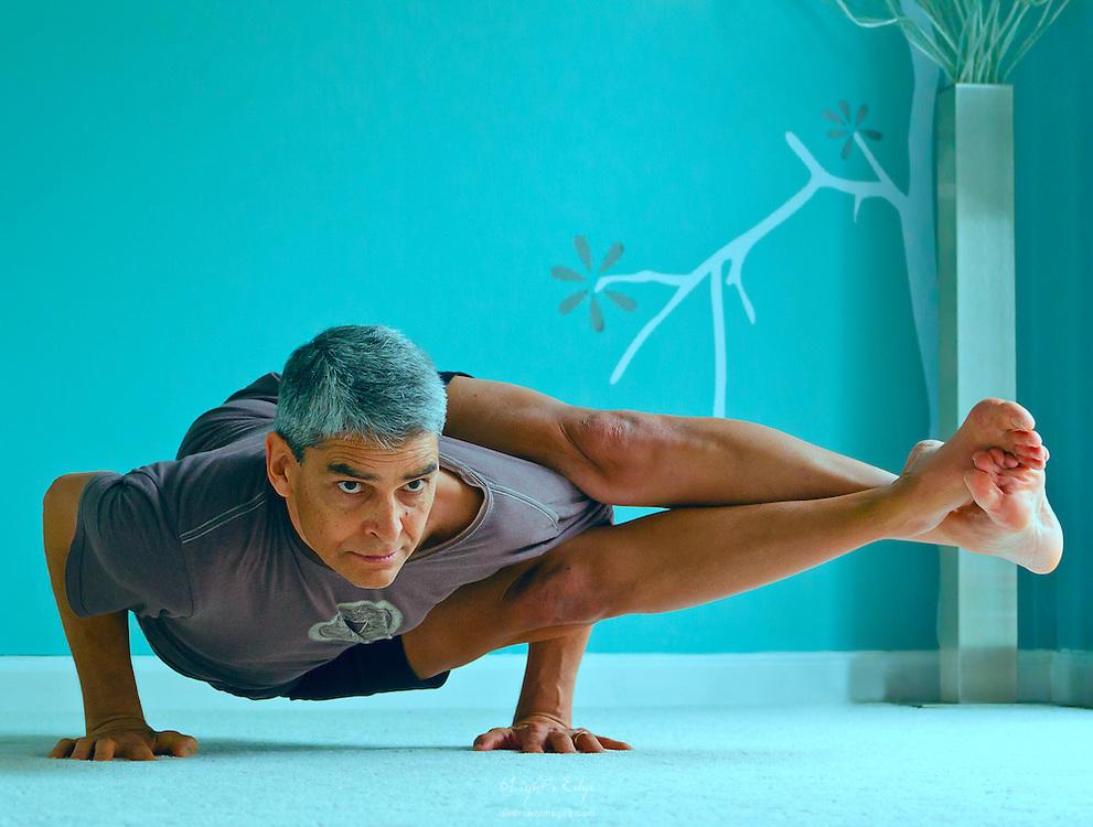 Eric Marrero providing a yoga postion for Pitman EDC marketing campaign.