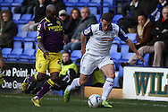 Tranmere Rovers' Jason Koumas (r) is chased by Notts County's Jamal Campbell-Ryce. Skybet football league one match, Tranmere Rovers v Notts county at Prenton Park in Birkenhead, England on Saturday 15th March 2014.<br /> pic by Chris Stading, Andrew Orchard sports photography.