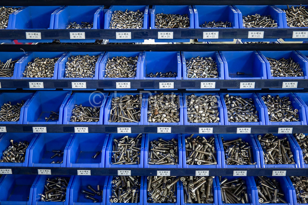 Nuts and bolts sit in their trays on an automation equipment assembly line at a Lyric Robot factory, operated by Guangdong Li Yuanheng Intelligent Automation Co., in Huizhou, Guangdong province, China, on Monday, April 18, 2016. Once synonymous with Chinas manufacturing might, as the days of cheap land and labor recede, the provinces businesses are in a race to upgrade or move.