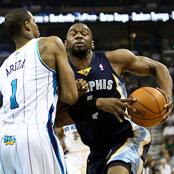 April 1, 2011; New Orleans, LA, USA; Memphis Grizzlies shooting guard Sam Young (4) collides with New Orleans Hornets small forward Trevor Ariza (1) during the first quarter at the New Orleans Arena.    Mandatory Credit: Derick E. Hingle