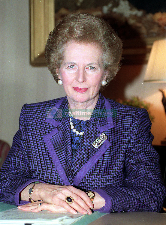 File photo dated 15/11/1990 of Margaret Thatcher at her desk in 10 Downing Street. She has been voted sixth in a list of women who have made the most significant impact on world history.