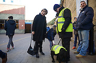 Delia Smith CBE, majority shareholder at Norwich City stops to chat and poses for a photo with one of the Security Team members and sniffer dogs outside Stamford Bridge ahead of the match.. Barclays Premier league match, Chelsea v Norwich city at Stamford Bridge in London on Saturday 21st November 2015.<br /> pic by John Patrick Fletcher, Andrew Orchard sports photography.