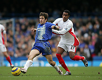 Photo: Lee Earle.<br /> Chelsea v Birmingham City. The Barclays Premiership.<br /> 31/12/2005.<br /> Birmingham's Julian Gray (R) holds back Joe Cole.