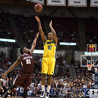 UNCW's C.J. Bryce shoots over College of Charleston's Marquise Pointer during the second half of the Seahawks 78-69 win over College of Charleston in the CAA Men's Basketball Championship game in Charleston, S.C., Monday, March 6, 2017. (AP Photo/Mike Spencer)
