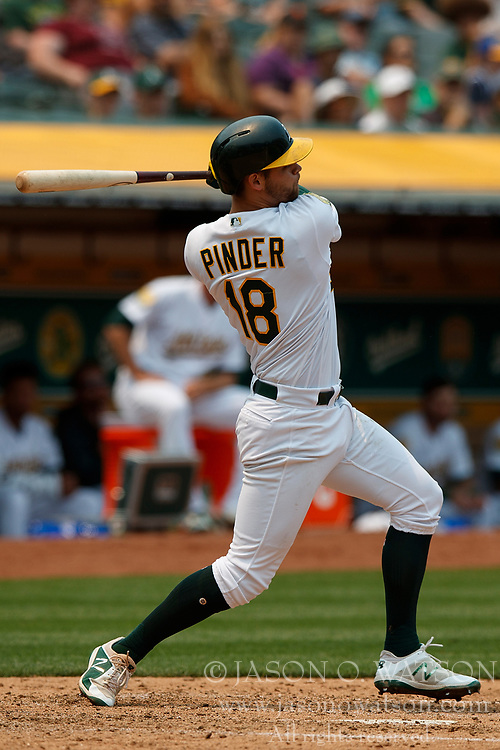 OAKLAND, CA - JULY 01:  Chad Pinder #18 of the Oakland Athletics at bat against the Cleveland Indians during the fourth inning at the Oakland Coliseum on July 1, 2018 in Oakland, California. The Cleveland Indians defeated the Oakland Athletics 15-3. (Photo by Jason O. Watson/Getty Images) *** Local Caption *** Chad Pinder