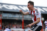 Brentford Sergi Canos (47) celebrates a goal from Brentford defender Yoann Barbet (29) (score 1-0) during the EFL Sky Bet Championship match between Brentford and Queens Park Rangers at Griffin Park, London, England on 22 April 2017. Photo by Andy Walter.
