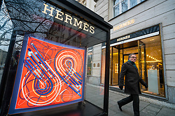 Glass display cabinet for luxury boutique Hermes on famous shopping street Kurfurstendamm , Kudamm, in Berlin, Germany.