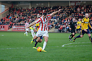 Terry Gornell has a shot during the Sky Bet League 2 match between Cheltenham Town and Oxford United at Whaddon Road, Cheltenham, England on 29 November 2014.