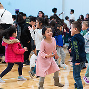 Students and teachers dance during a ribbon cutting ceremony in the new gymnasium at Eastwood Elementary School in Hillsboro, Ore., on Tuesday, Feb. 4, 2020.