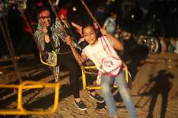 June 28, 2017 - Gaza, gaza strip, Palestine - Palestinian children play in a park on the fourth day of Eid al-Fitr, which marks the end of the holy month of Ramadan. Eid al - Fitr holiday celebrations, Gaza City - 28 June 2017. (Credit Image: © Majdi Fathi/NurPhoto via ZUMA Press)