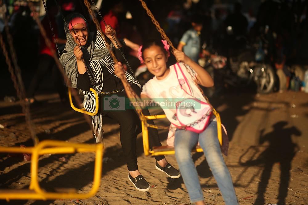 June 28, 2017 - Gaza, gaza strip, Palestine - Palestinian children play in a park on the fourth day of Eid al-Fitr, which marks the end of the holy month of Ramadan. Eid al - Fitr holiday celebrations, Gaza City - 28 June 2017. (Credit Image: © Majdi Fathi/NurPhoto via ZUMA Press)