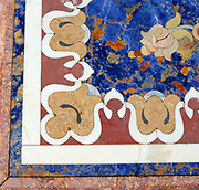 Detail from a 19th century marble table from Italy. Using colourful floral inlays to create the design.