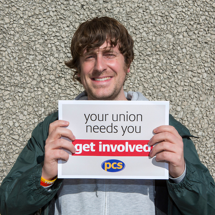 Mark Peirce, trainee delegate group, holding up the Get Involved campaign cards. PCS, Annual Delegate Conference 2015, Brighton.
