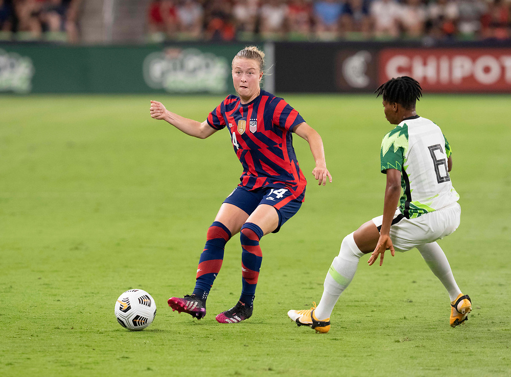 USA's EMILY SONNETT (14) drives past CHARITY ADULE (6)                               as the US Women's National Team (USWNT) beats Nigeria, 2-0 in the inaugural match of Austin's new Q2 Stadium. The U.S. women's team, an Olympic favorite, is wrapping up a series of summer matches to prep for the Tokyo Games.
