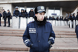 © Licensed to London News Pictures. 05/03/2014. Ukraine. Police guard the administrative building in Donetsk. Demonstration involving groups of pro-Russia and anti-Putin protestors, in the wake of events in Kyiv. . Photo credit : Christopher Nunn/LNP