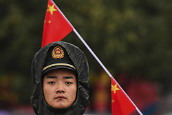 October 21, 2018 - Guilin, China - A soldier seen near the start area as very high security presence at the start/finish line of the six and final stage, 169km Guilin Stage, of the 2nd Cycling Tour de Guangxi 2018. .On Sunday, October 21, 2018, in, Guilin, China. (Credit Image: © Artur Widak/NurPhoto via ZUMA Press)