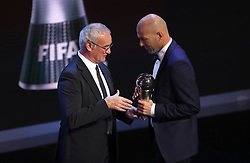 Zinedine Zidane accepts the award for FIFA Mens Coach of the Year from Claudio Ranieri during the Best FIFA Football Awards 2017 at the Palladium Theatre, London.