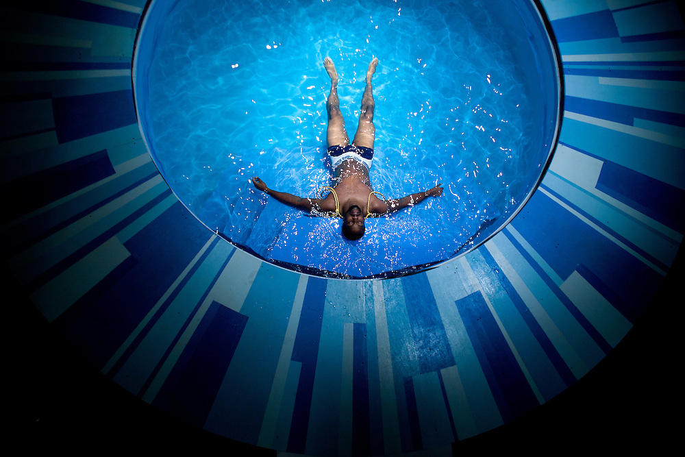 Aaron Alexander, as Ceyx, floats in a circular pool at center stage during a rehearsal of Metamorphoses, a play by Mary Zimmerman, at the Zach Scott Theater.